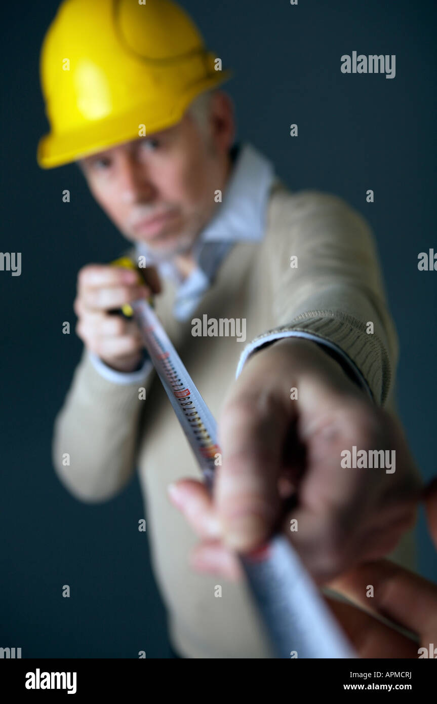 Architect holding metric tape - Stock Image
