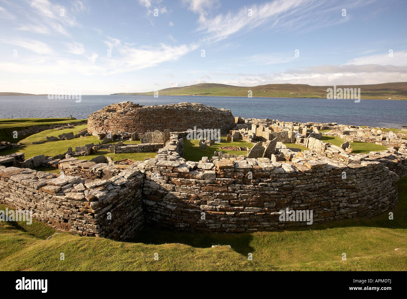 Broch of Gurness looking over Eynhallow Sound and Rousay Island Orkney Scotland UK - Stock Image