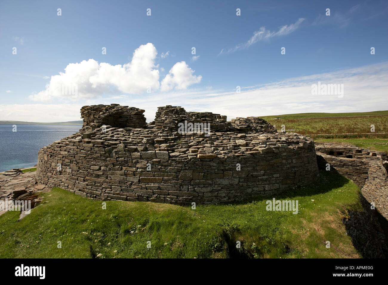 Midhowe Broch iron aged fortified stronghold facing Eynhallow Sound Rousay Isalnd Orkney Scotland UK - Stock Image