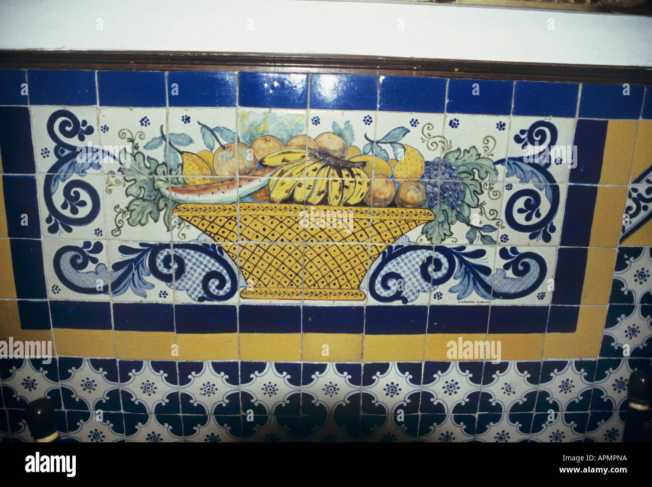 A display of azulejos tiles decorating the interior of Mexico City s Cafe de Tacuba situated in a former convent - Stock Image