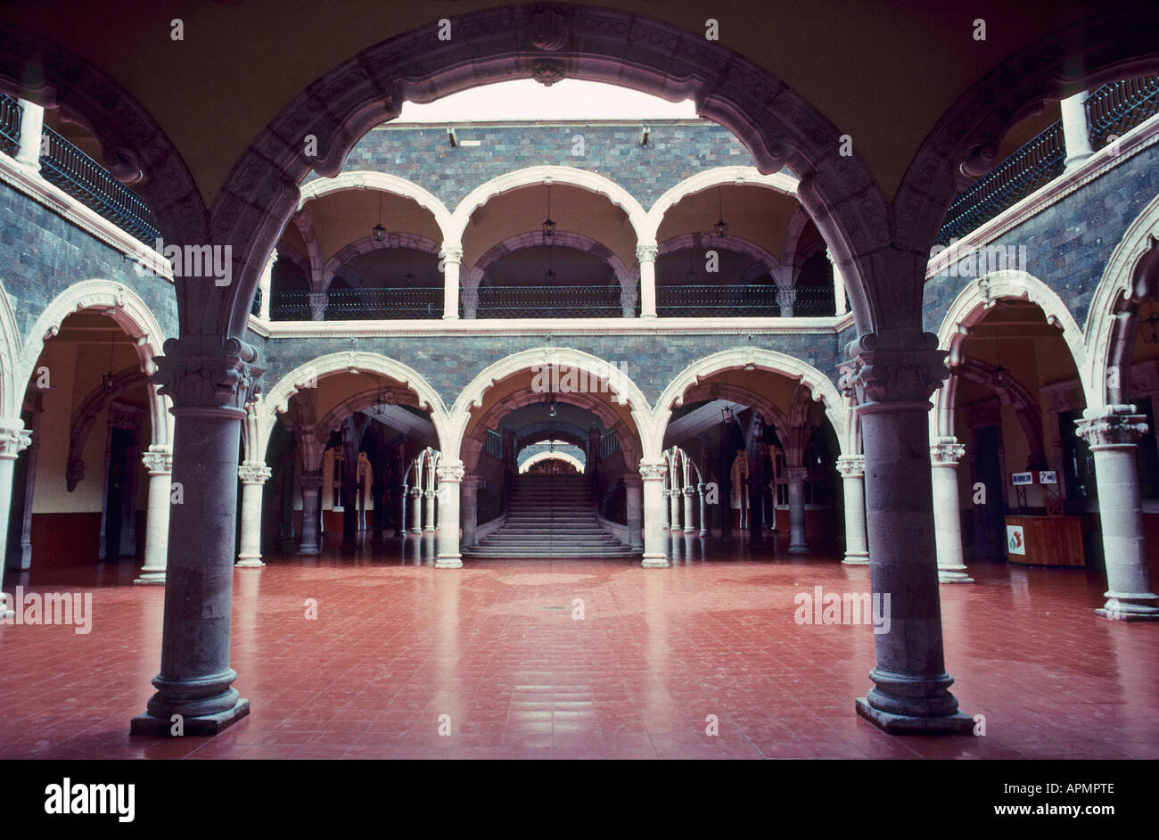 The courtyard with its two tiers of pillared archways of the Palacio del Gobierno which was the residence of the wealthy Rincon Gallardo family in Aguascalientes - Stock Image
