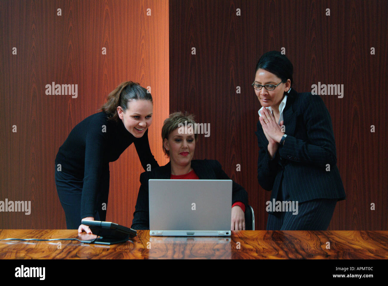 Businesswomen in boardroom Stock Photo