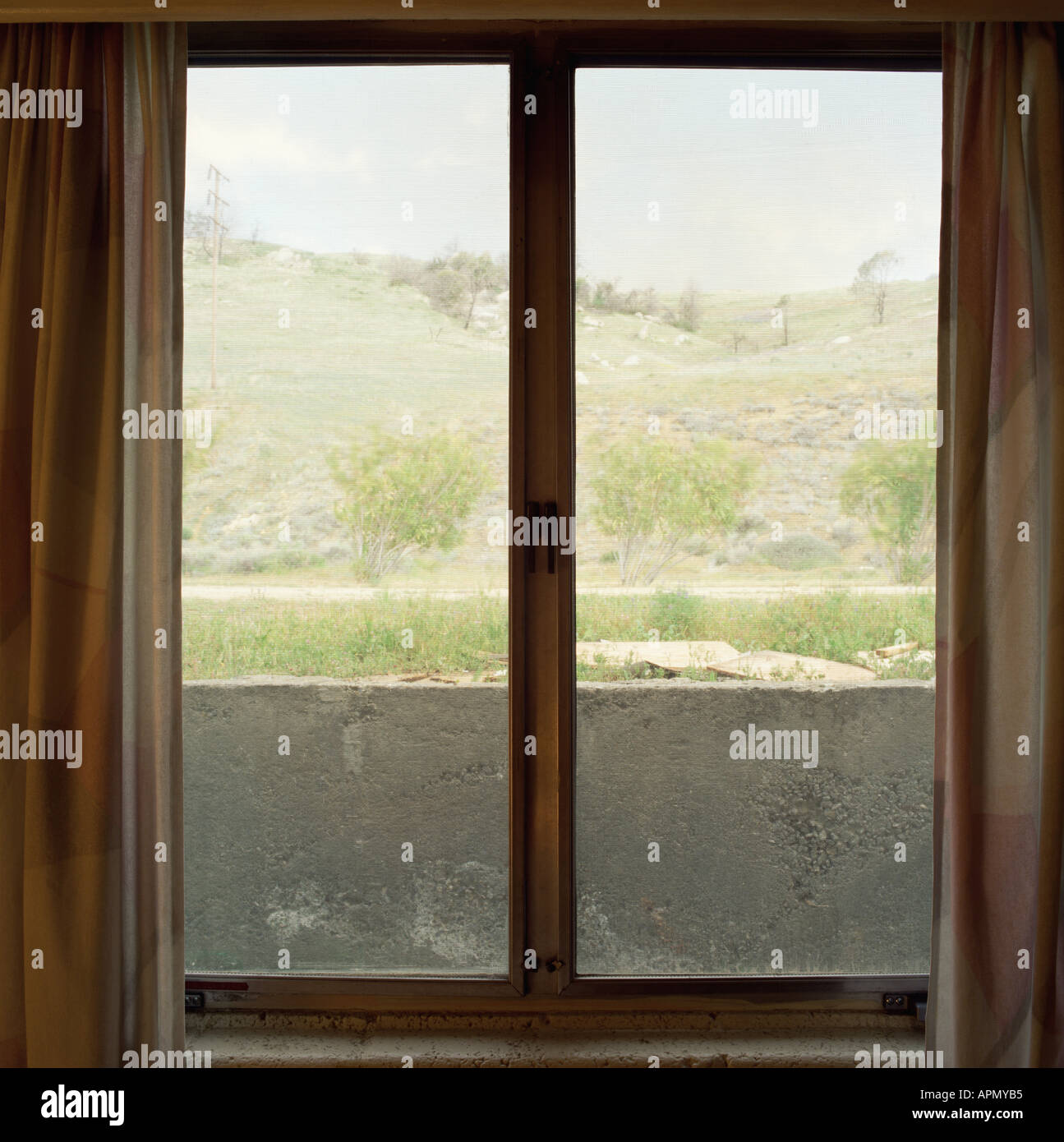 Desolate view through a window - Stock Image