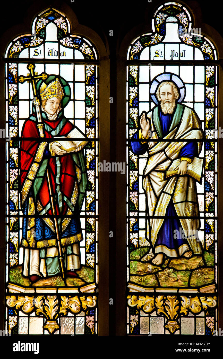 Stained Glass in the Parish Church in the village of Hovingham in North Yorkshire in Great Britain - Stock Image