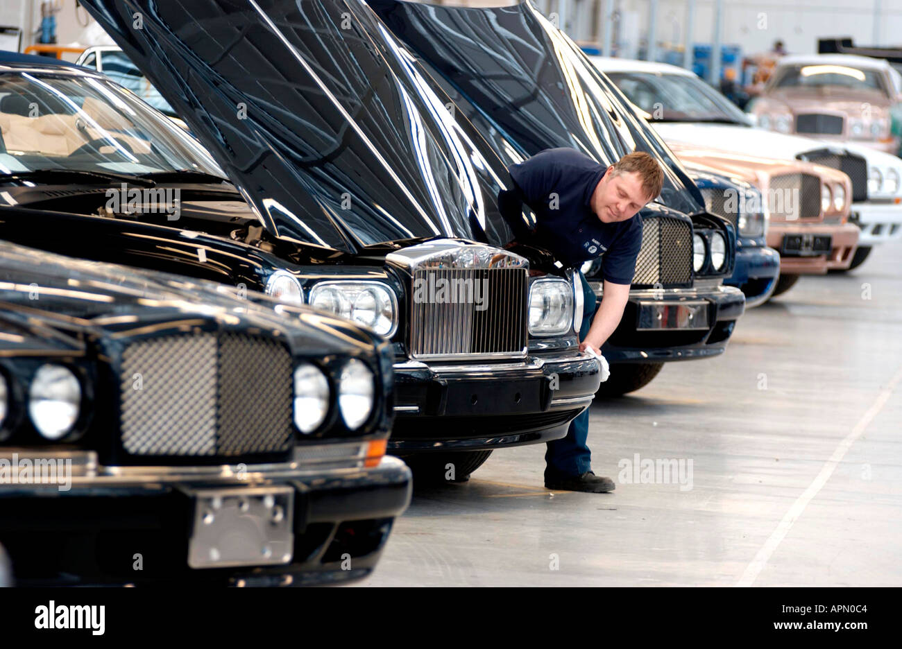 Brand new Bentleys and Rolls Royce luxury cars getting final polish and inspection before leaving the factory - Stock Image