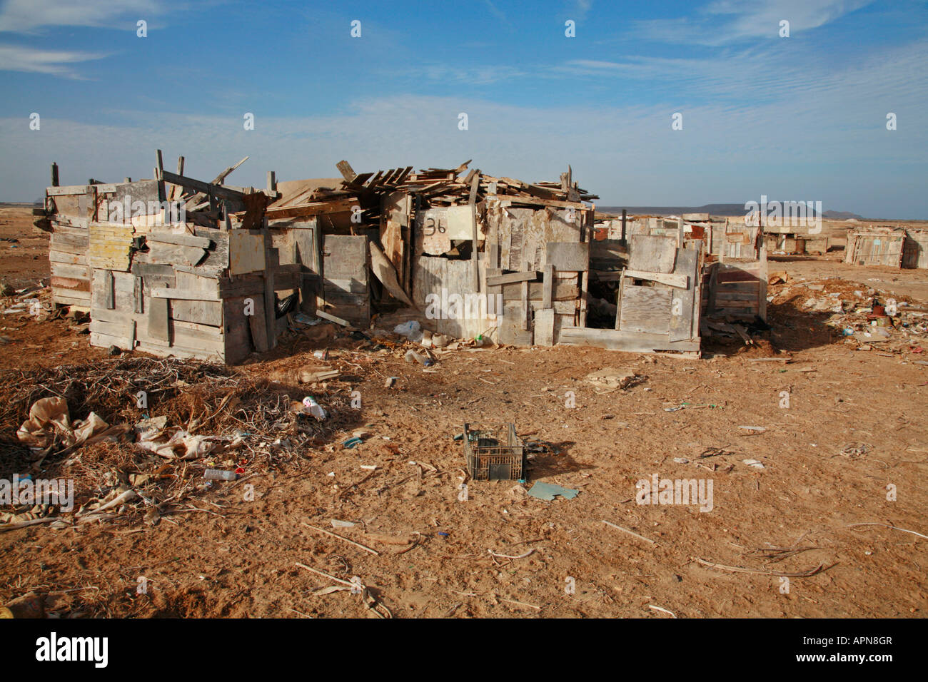 Shanty housing behind the tourist resort of Santa Maria on the Cape Verde island of Sal - Stock Image