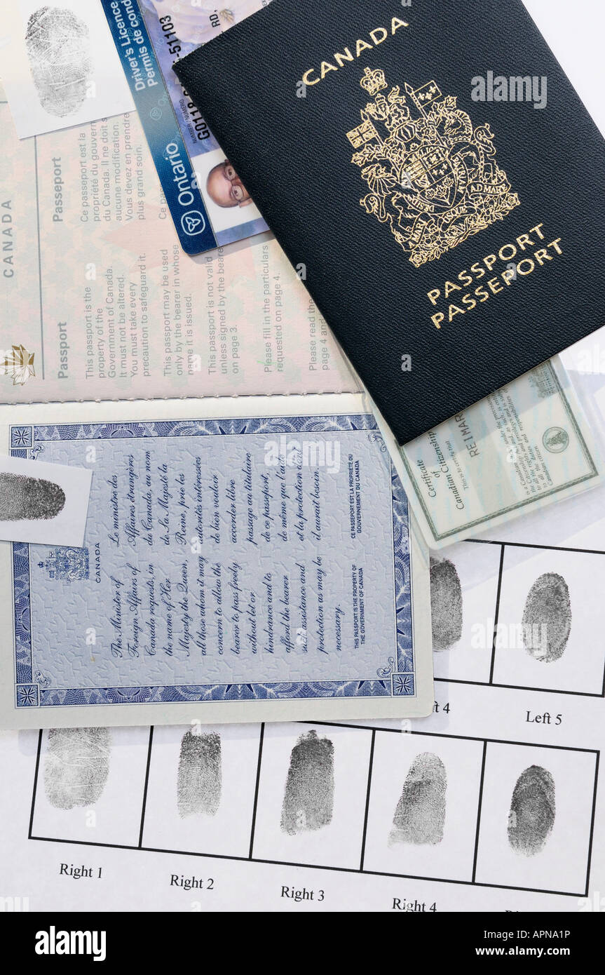 Collection of passport identity cards and finger prints for identification for security and proof of citizenship - Stock Image