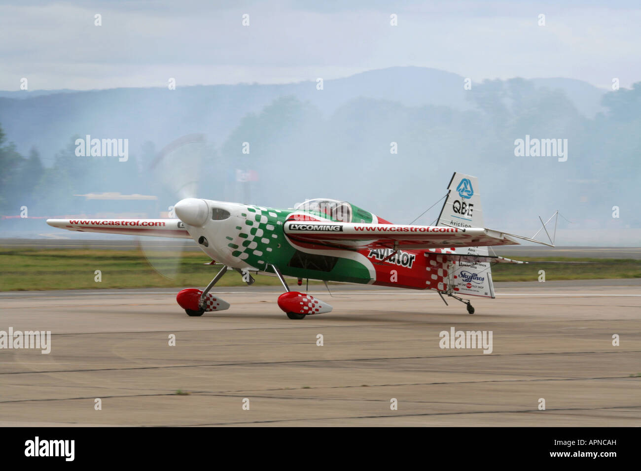 Zivko Edge 540 aerobatic display aircraft or stunt plane. Slow shutter speed used for prop blur. - Stock Image