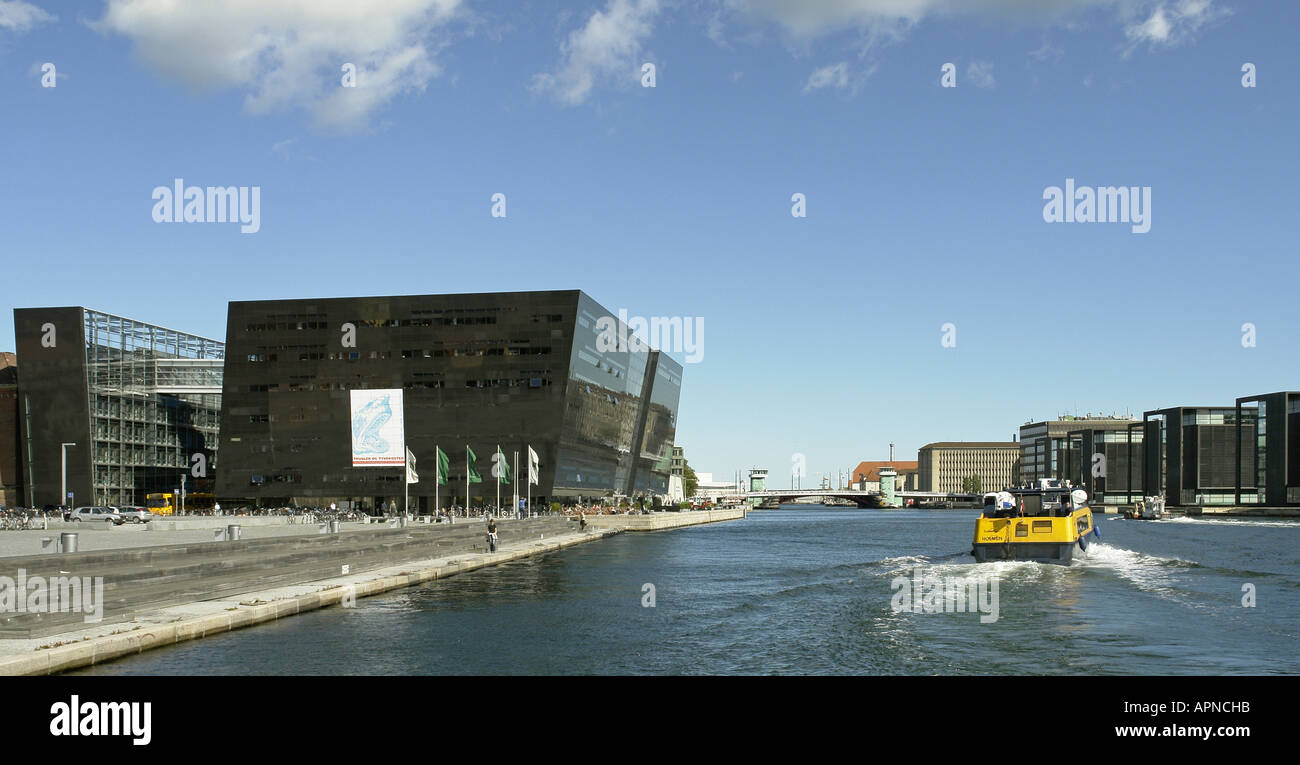 The Danish National Library is housed in the building termed Black Diamond spectacularly located on the waterfront in Copenhagen - Stock Image