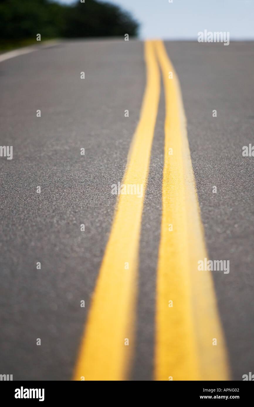 Yellow road markings - Stock Image