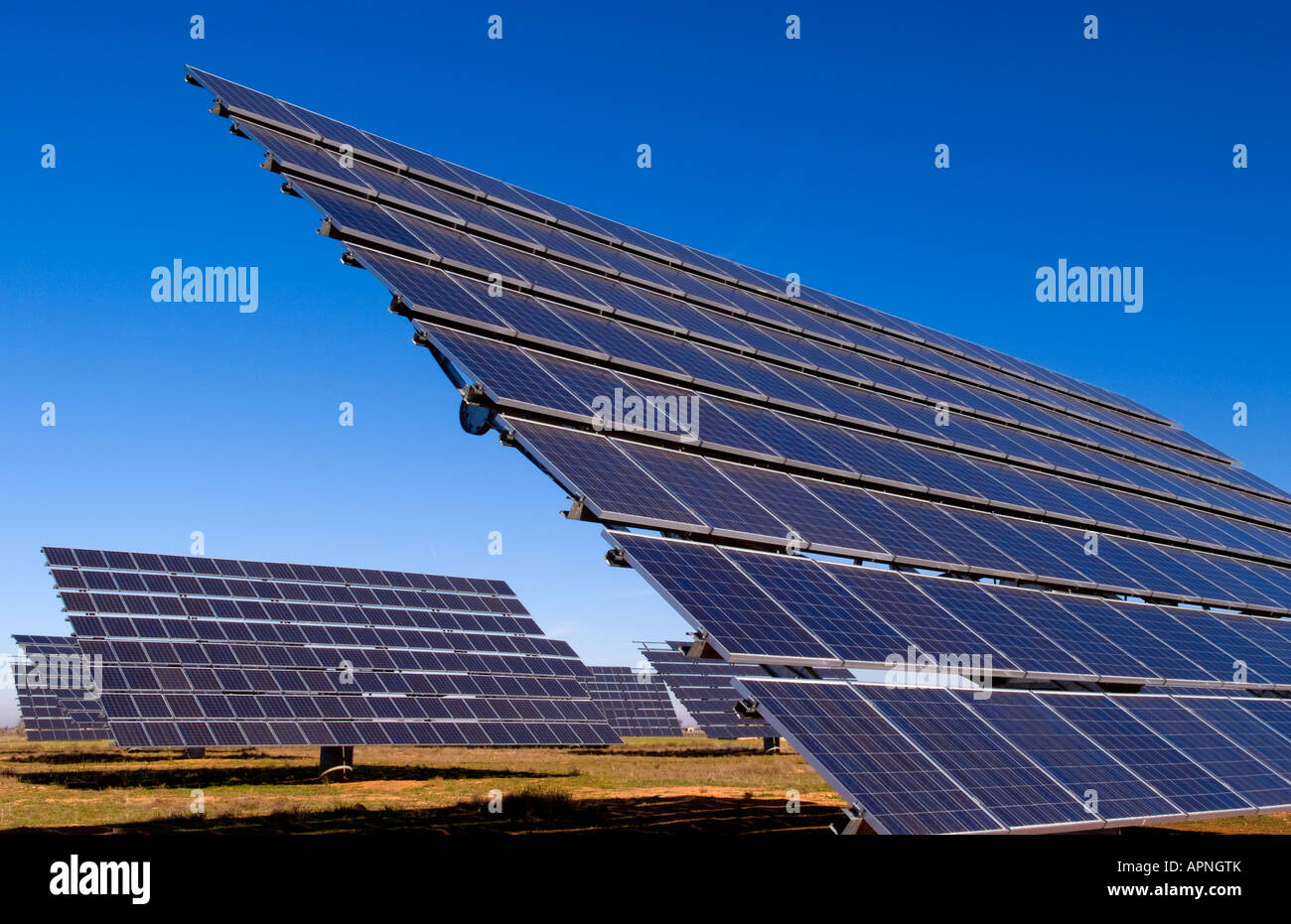 Abstract images of solar panels to store electricity and power near on electricity from gas, electricity from oil, electricity from windmills, electricity from geothermal, electricity from biomass, electricity from battery, electricity from wind,