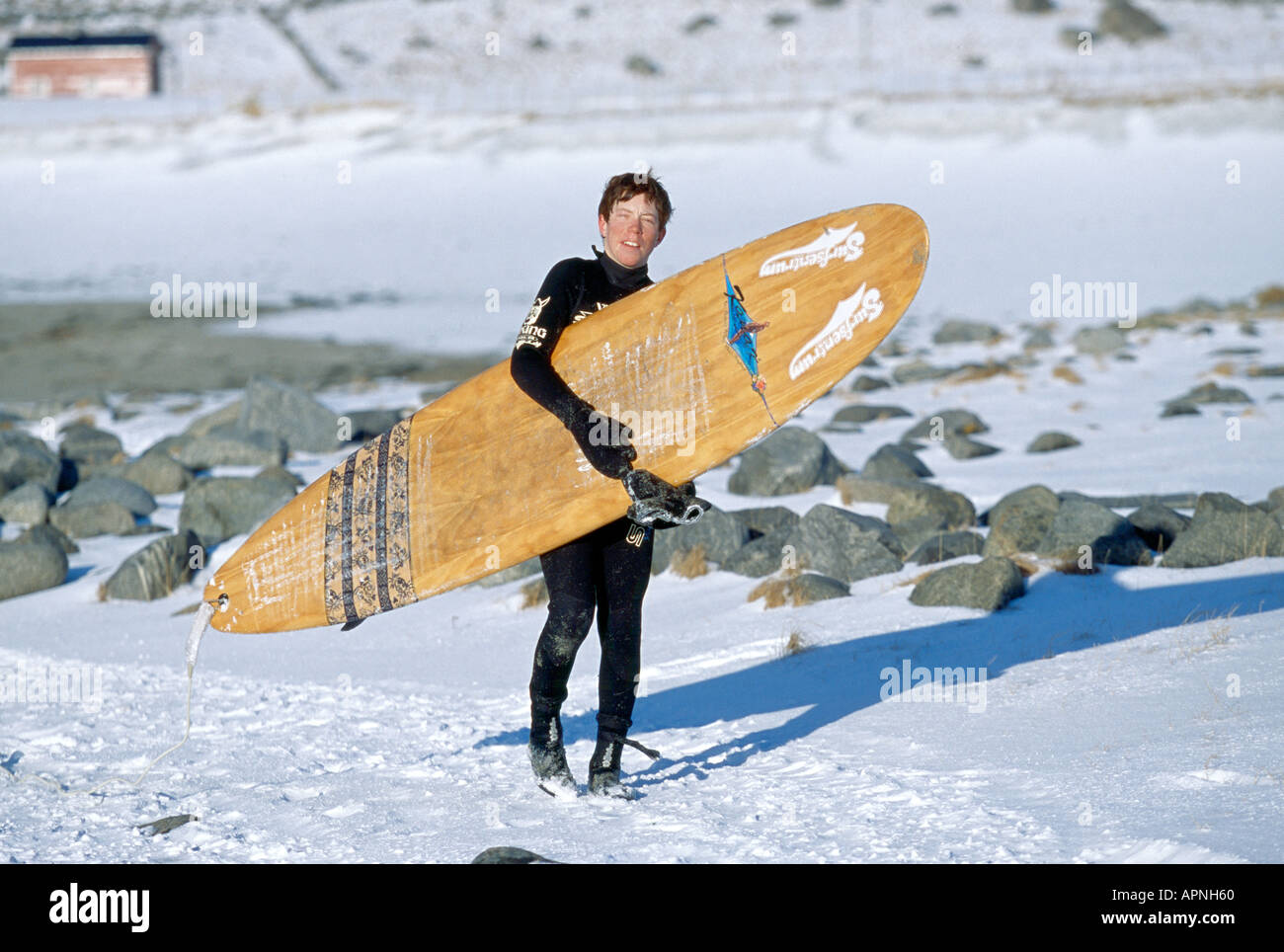 SHAUN WHITE ON BEACH WITH SURFBOARD IN SNOW, NORWAY - Stock Image