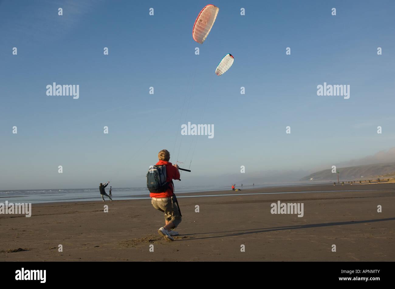 man person Powerkite kite flying Ynyslas Borth beach west wales UK January afternoon - Stock Image