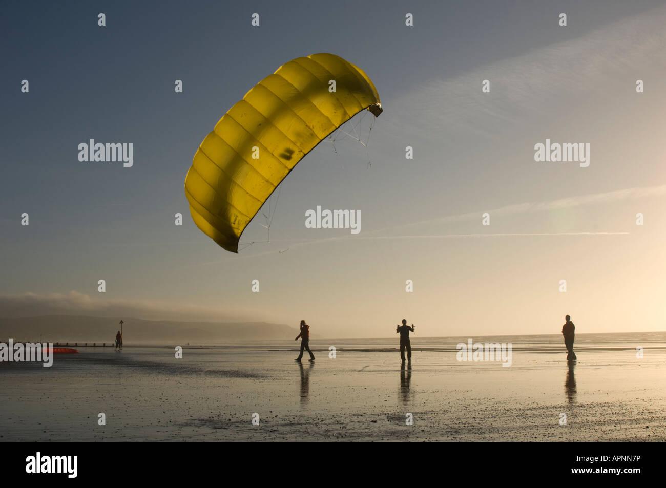 people Powerkite kite flying Ynyslas Borth beach west wales January late afternoon dusk sundown - Stock Image