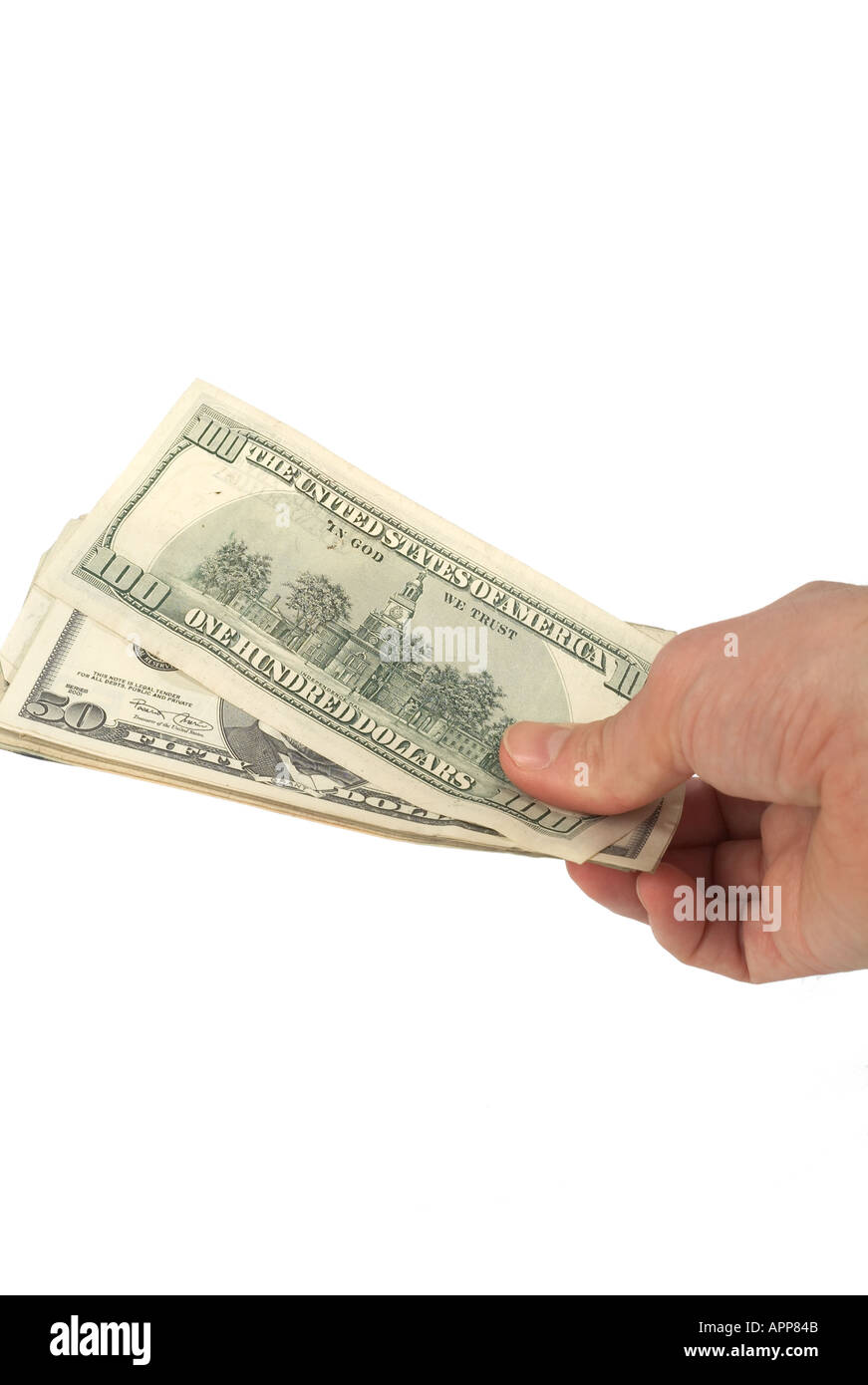 Cash money dough folding dollar exchange rate spend buy pay paid cash in hand money in pocket wallet fist full rich poor w - Stock Image