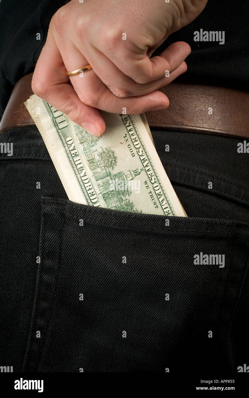 Cash money dough folding dollar pound exchange rate spend buy pay paid cash in hand money in pocket wallet fist full rich poor w - Stock Image