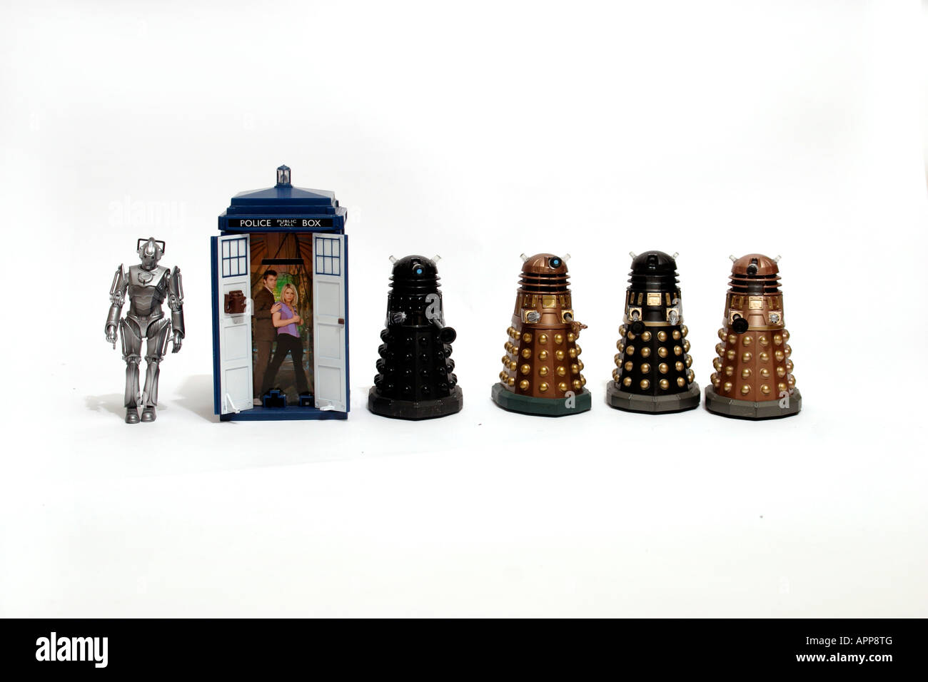 four toy Daleks, one Tardis, and one Cyberman. Daleks, the Tardis and cybermen are synonymous with the BBC TV series - Stock Image
