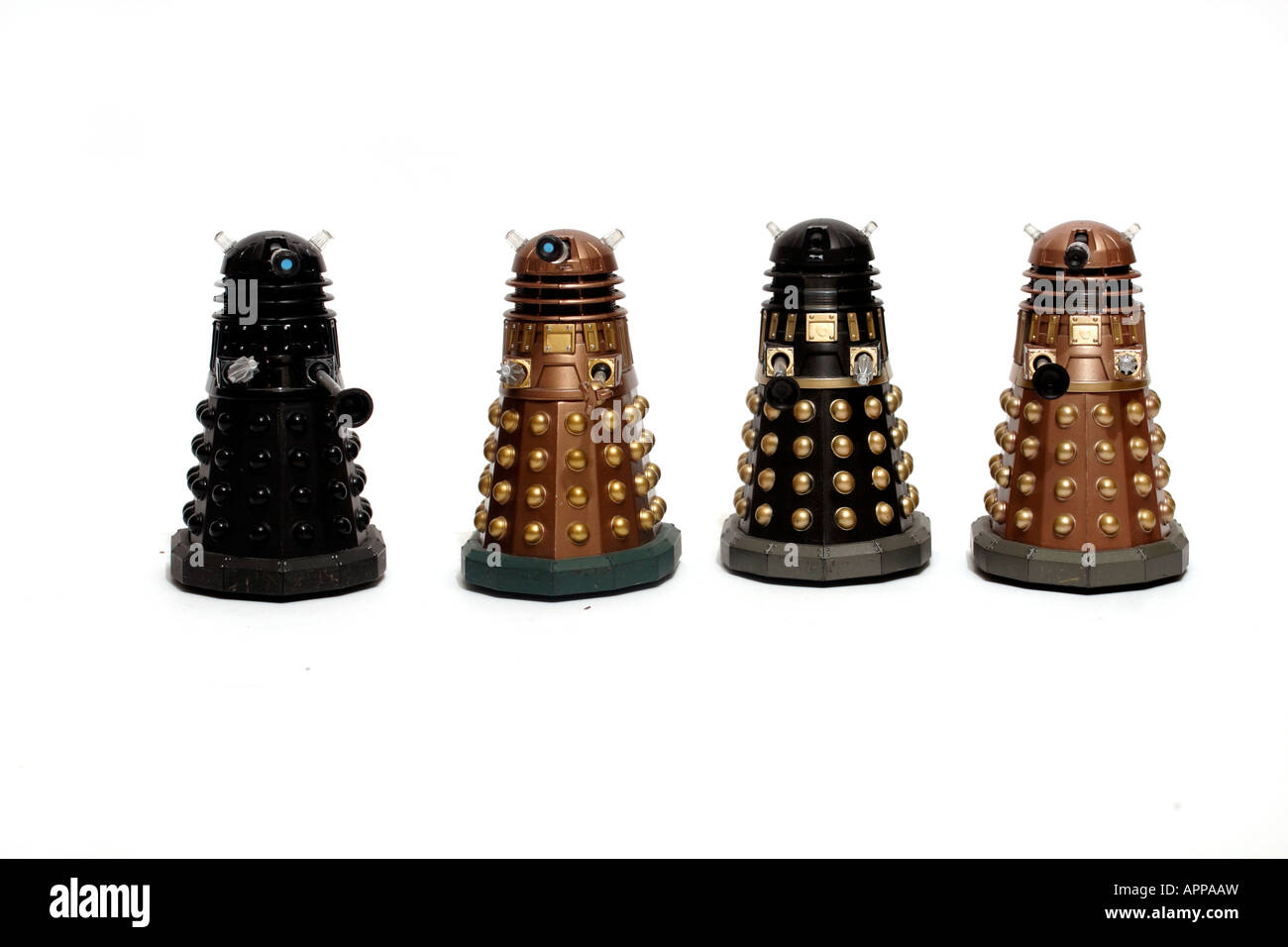 four toy Daleks.  Daleks are synonymous with the BBC TV series 'Doctor Who' - Stock Image