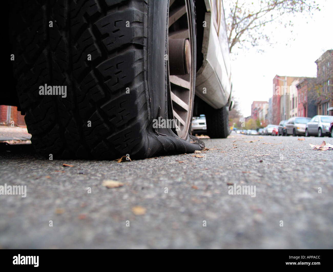 Deflated tire on street (close up), New York City, New York, USA - Stock Image