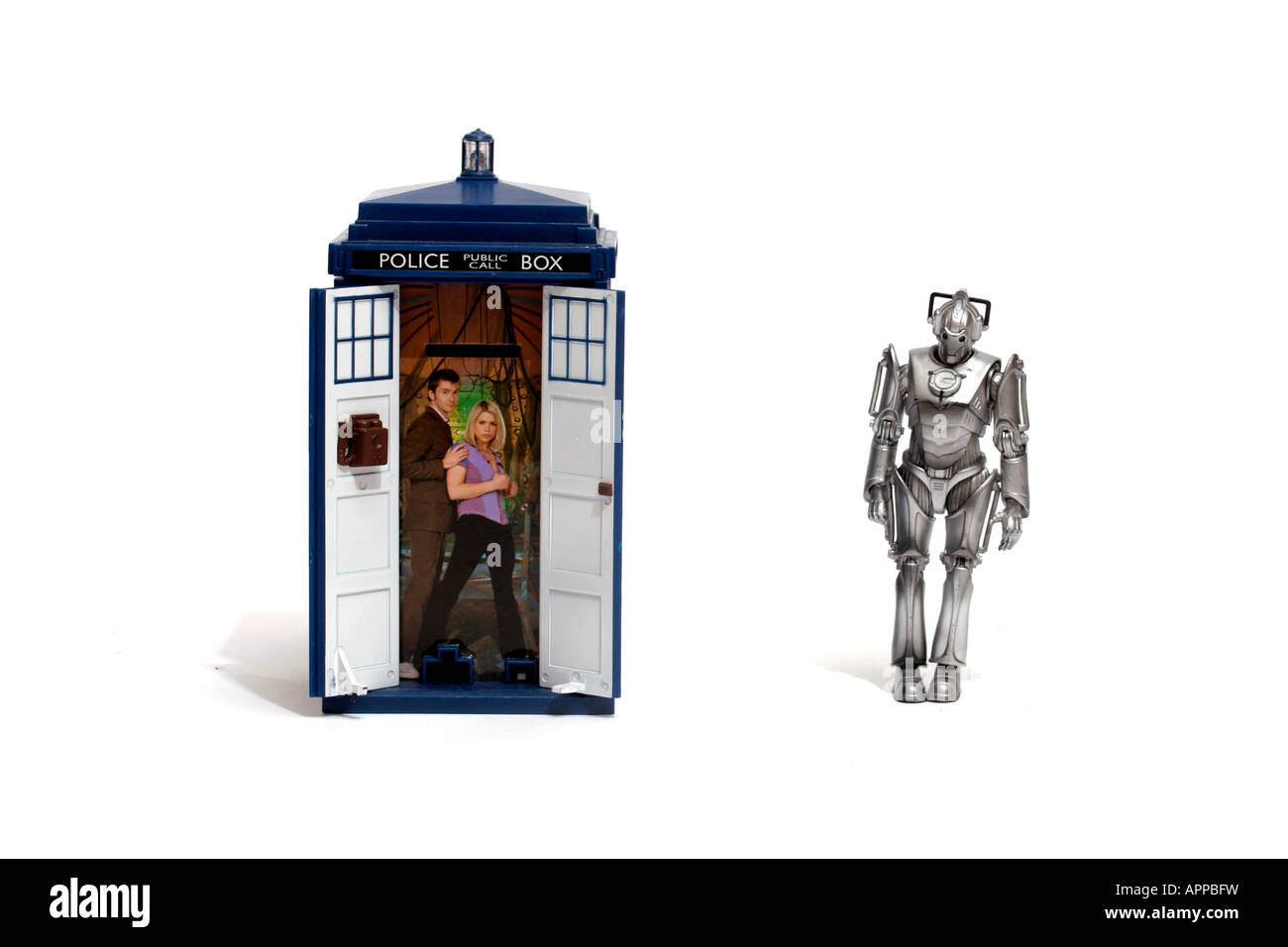 one Tardis, and one Cyberman. The Tardis and cybermen are synonymous with the BBC TV series 'Doctor Who'. Time and - Stock Image