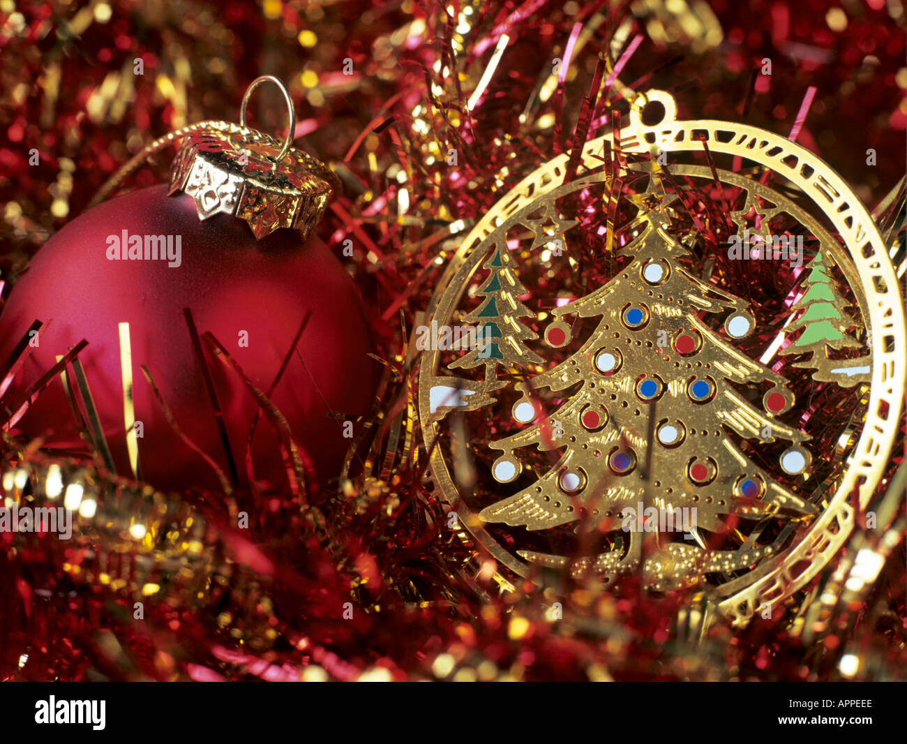 red and gold christmas tree decorations in close up england uk