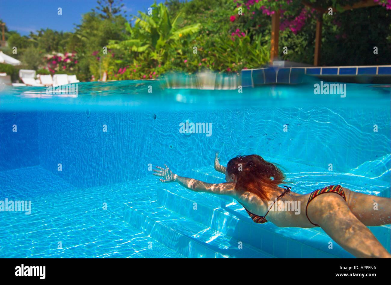 woman in bikini diving underwater in swimming pool hotel above water stock photo 9052565 alamy