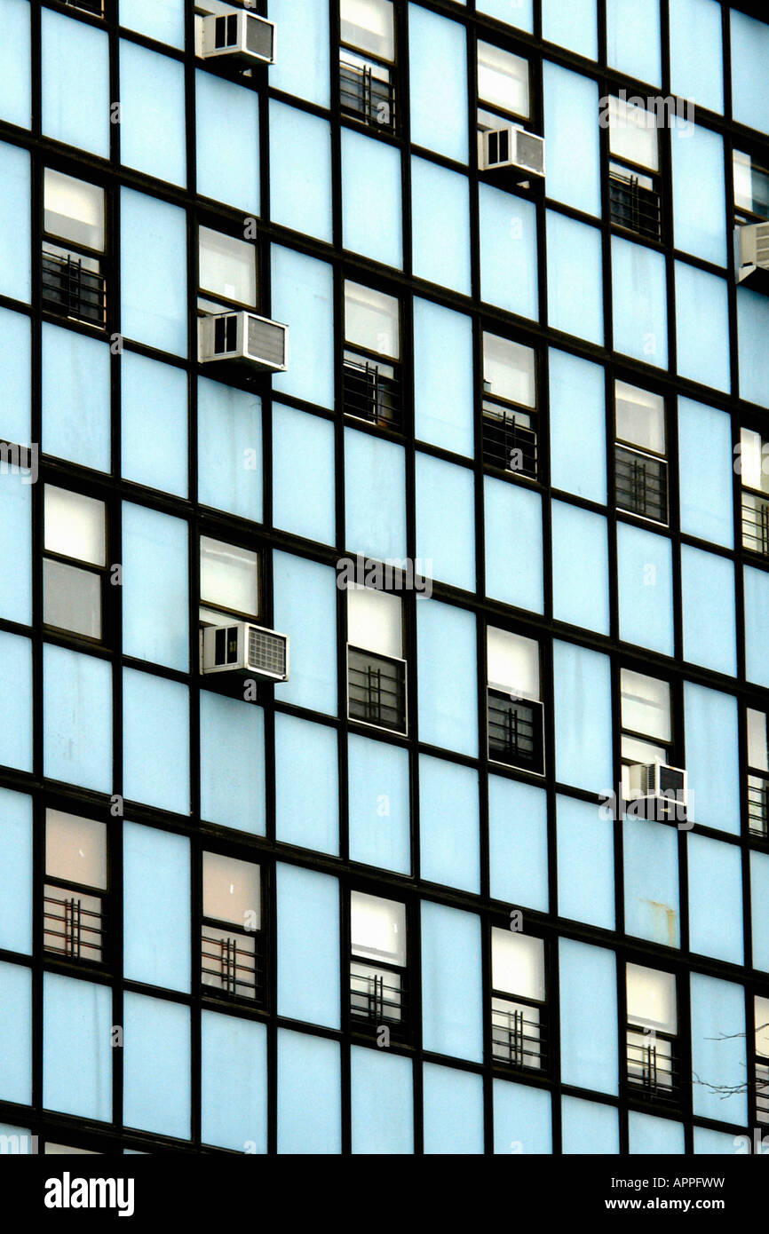 Facade Of A Pastel Blue Colored Apartment Building With Many Windows