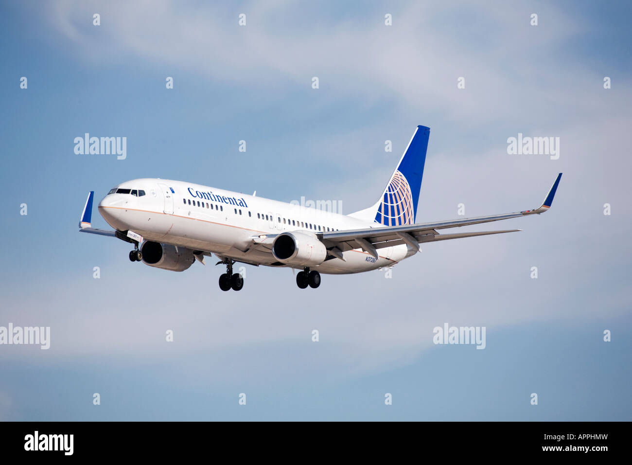 A Boeing B737 of Continental airlines on final approach - Stock Image