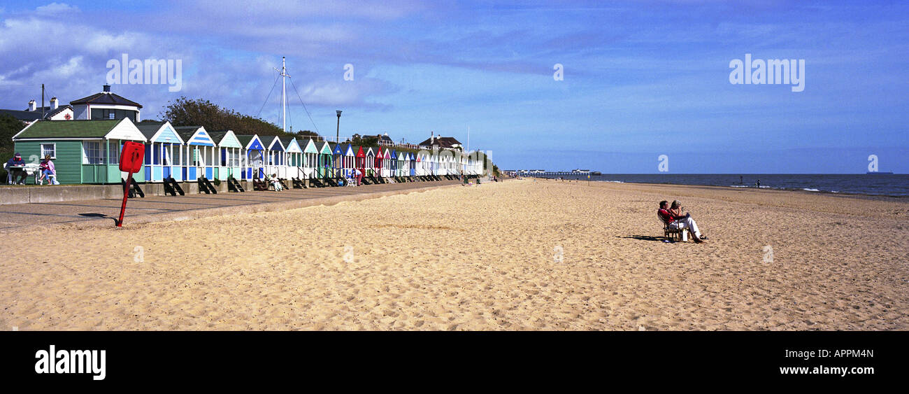 Sandy beach and beach huts in Southwold, Suffolk, UK - Stock Image