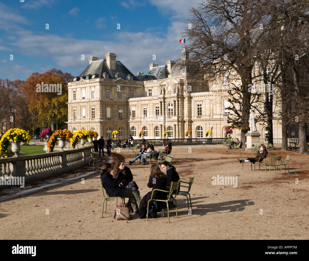 Jardin du Luxembourg gardens and palace with students sitting talking together, Paris - Stock Image