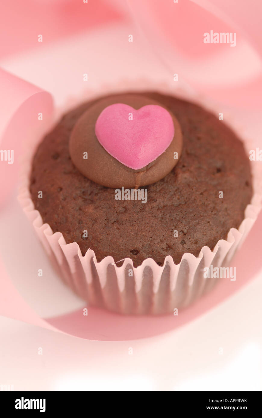 the taste of valentine - bun with heart shaped icing - Stock Image