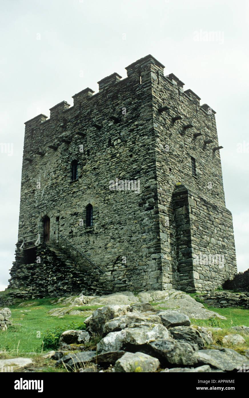Embattled rectangular tower keep of 13th century Dolwyddelan Castle Snowdonia - Stock Image