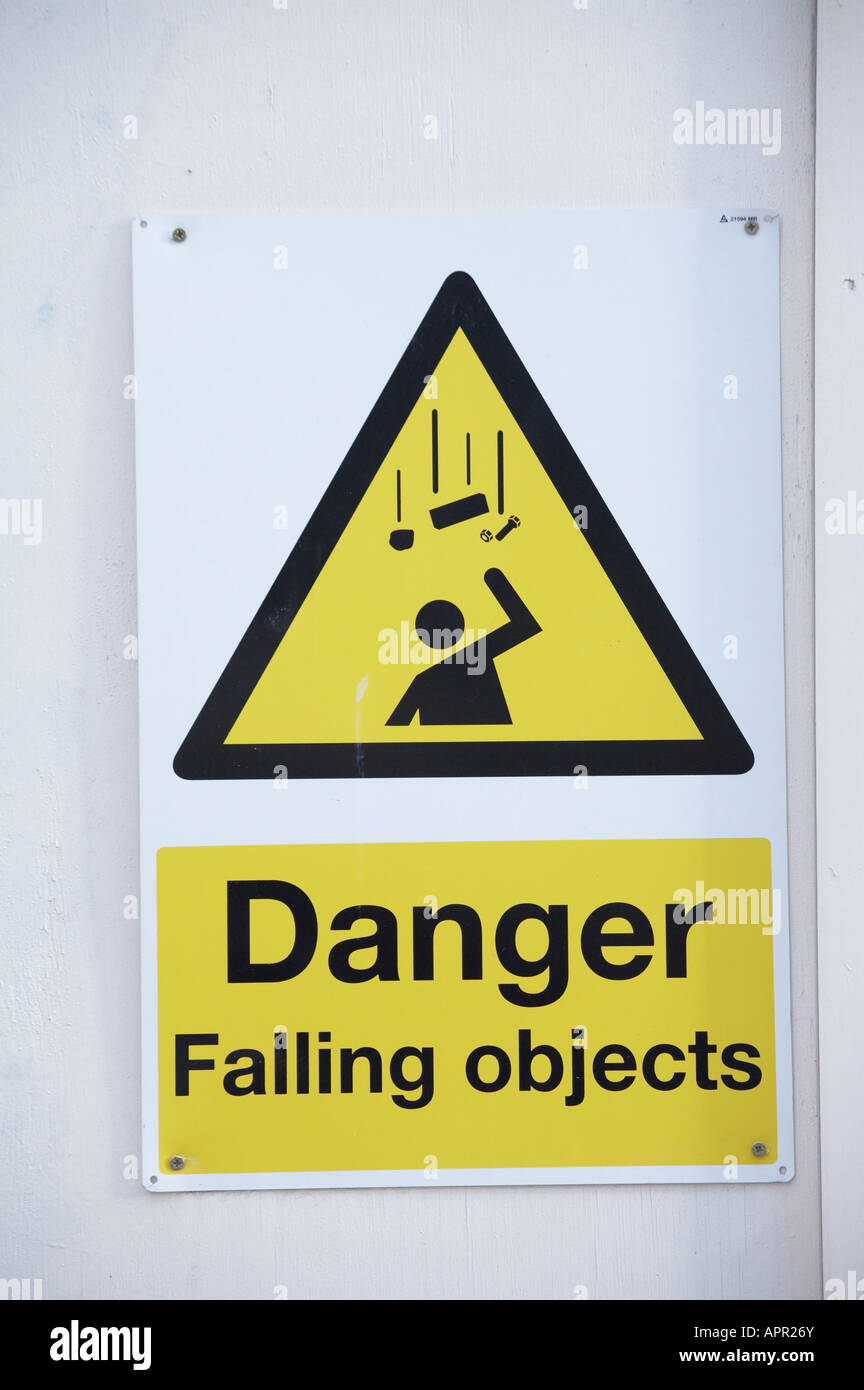 DANGER FALLING OBJECTS Health and safety warning sign on construction site in London england uk britain - Stock Image