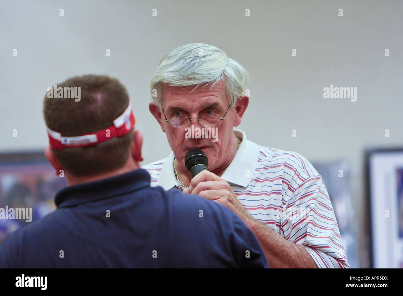 Man with a Microphone Making an Announcement - Stock Image