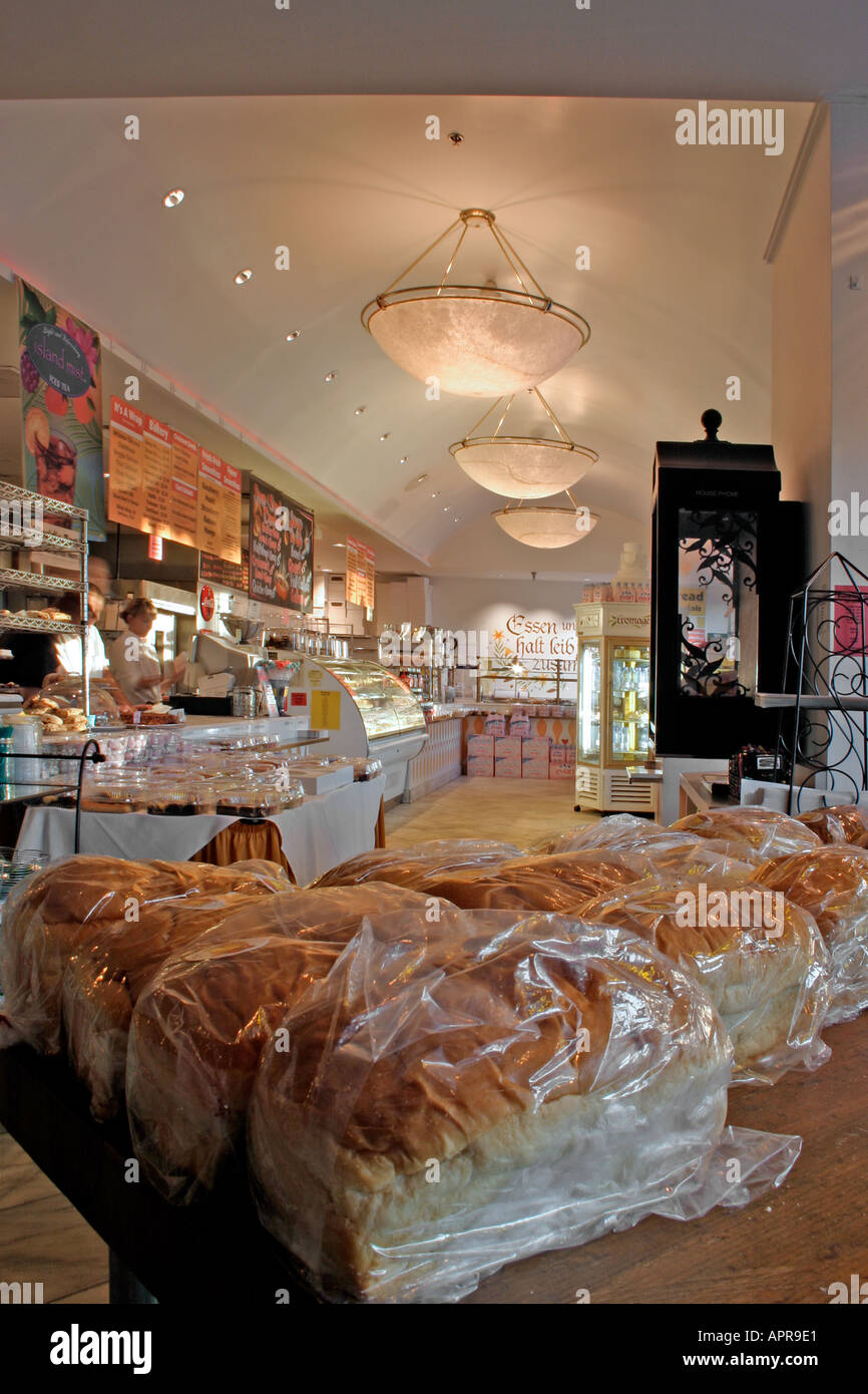 bread sell sales dough restaurant store bakery lights baker shelves shelf bag bags box boxes soda drink pop water juice - Stock Image