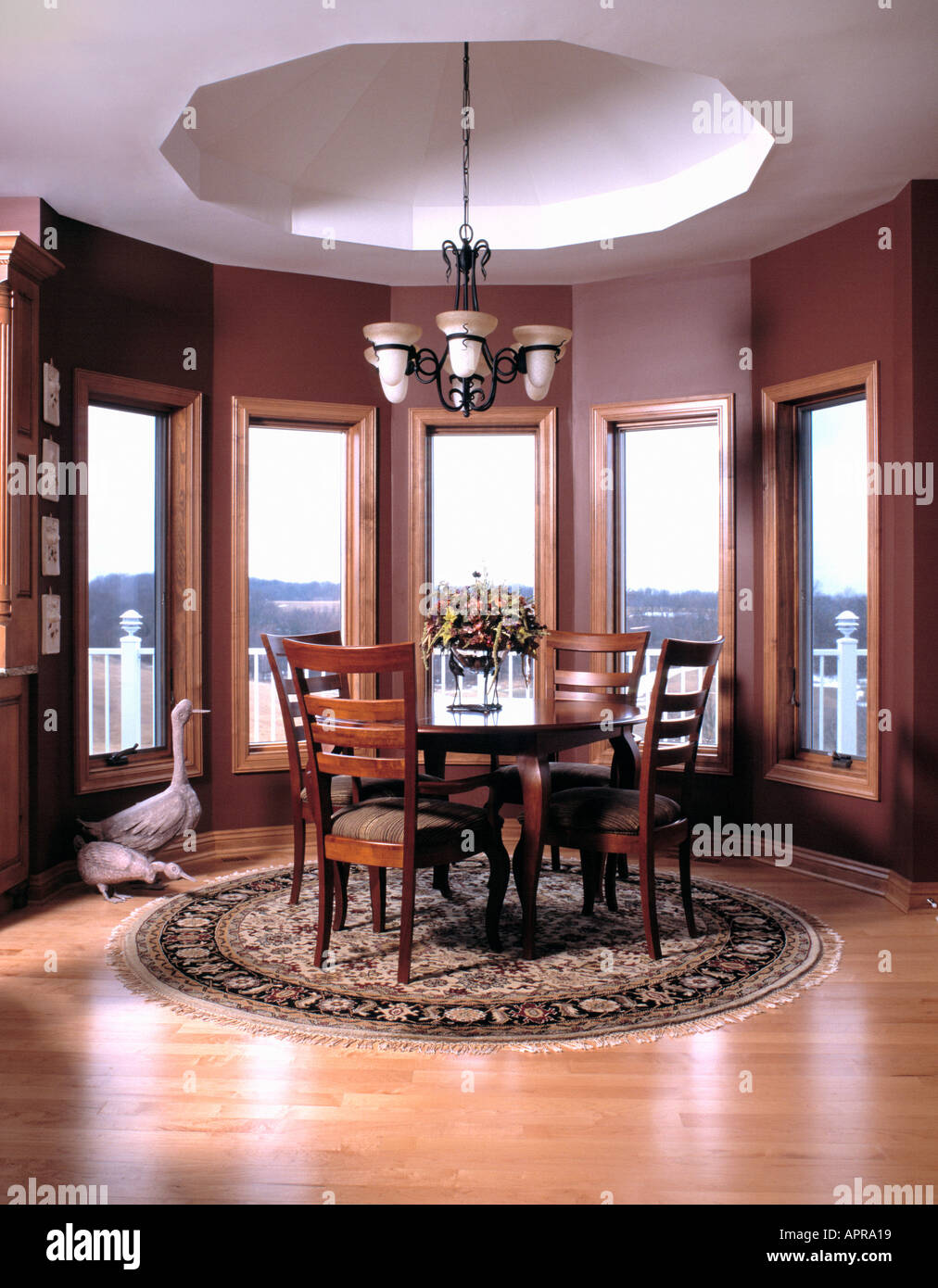dining room dinner lunch breakfast window table alcove wood floor hanging lights Stock Photo