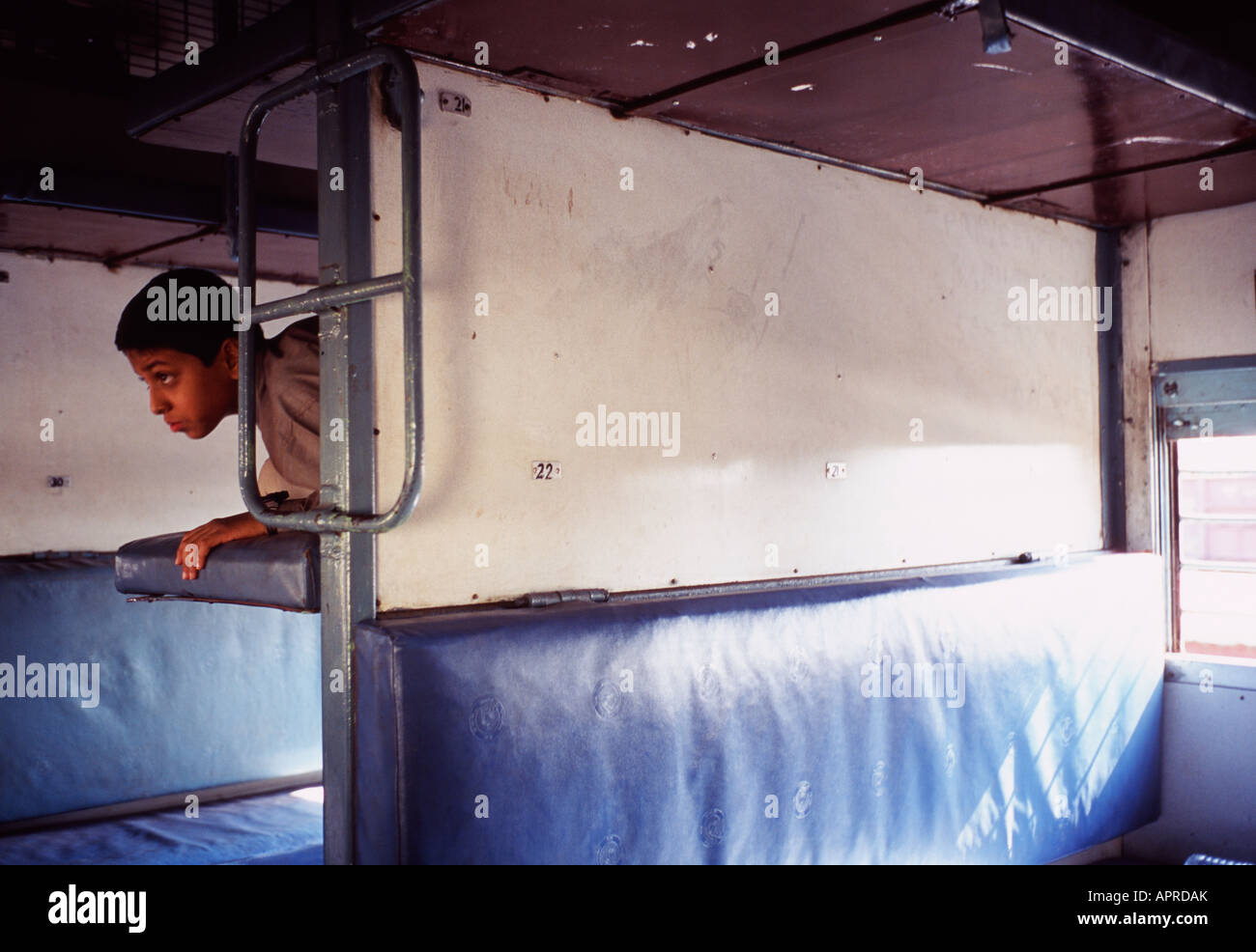 Indian boy on sleeper train, India - Stock Image