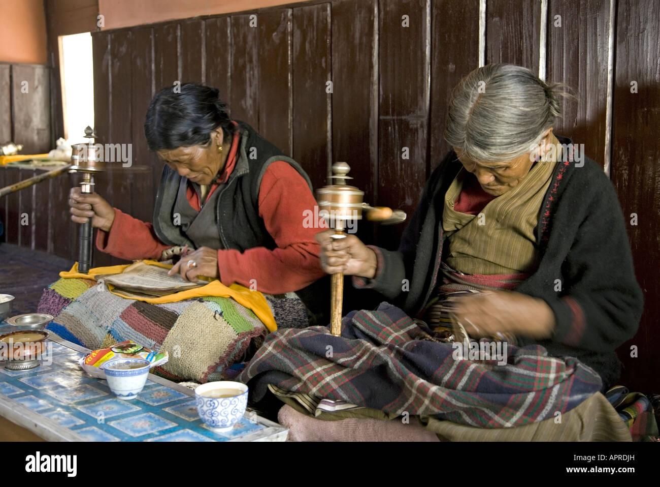 Tibetan women spinning her prayer wheels  Buddhist temple  Chhairo