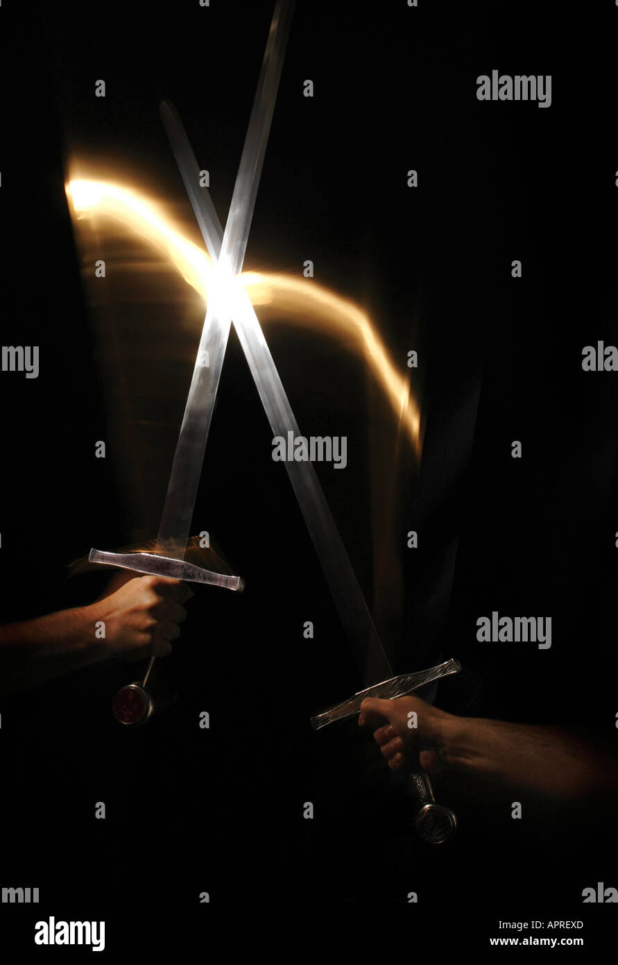 A clash of swords in the darkness. - Stock Image