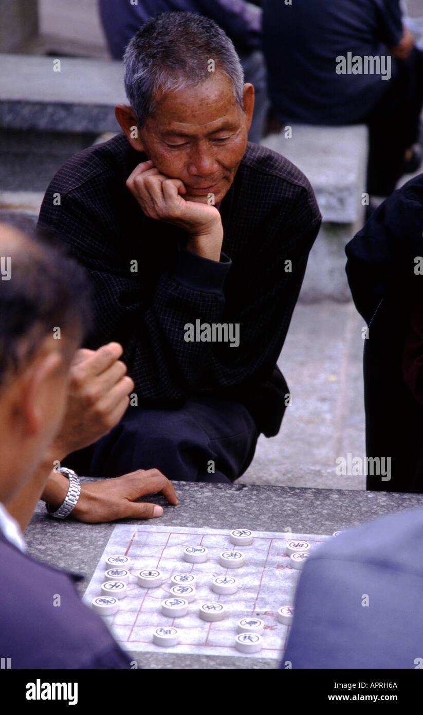 Man playing Chinese Chess in Dali Yunnan province China - Stock Image