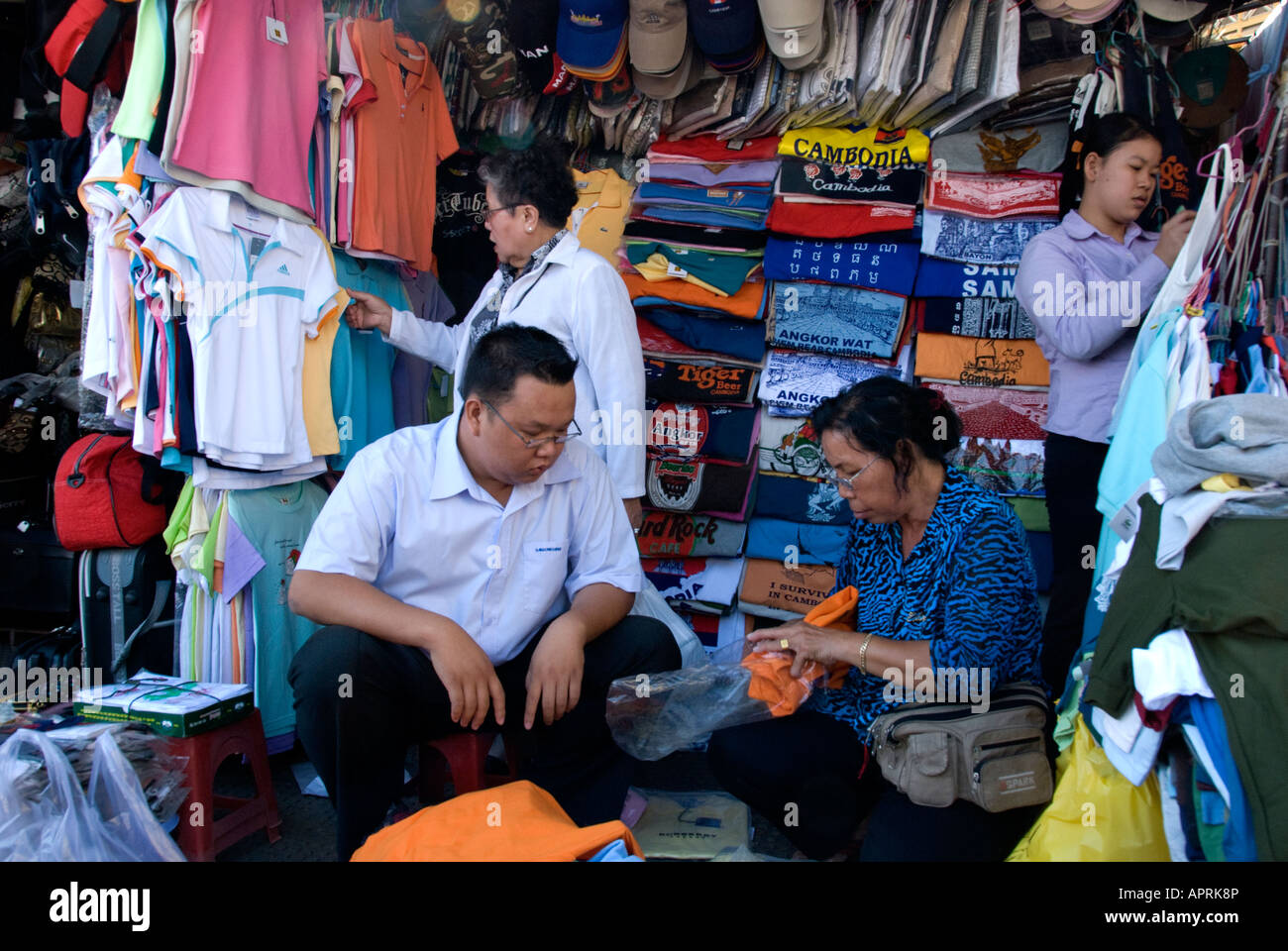 bartering at clothes' stall at Psar Thmei Market (also know as New Market or Central Market) Phnom Penh, Cambodia - Stock Image