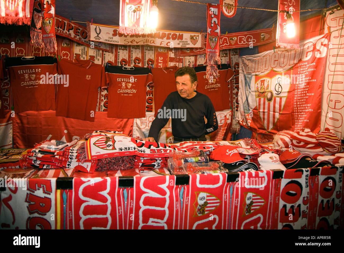 Stallholder of Sevilla FC merchandising goods, Seville, Spain - Stock Image