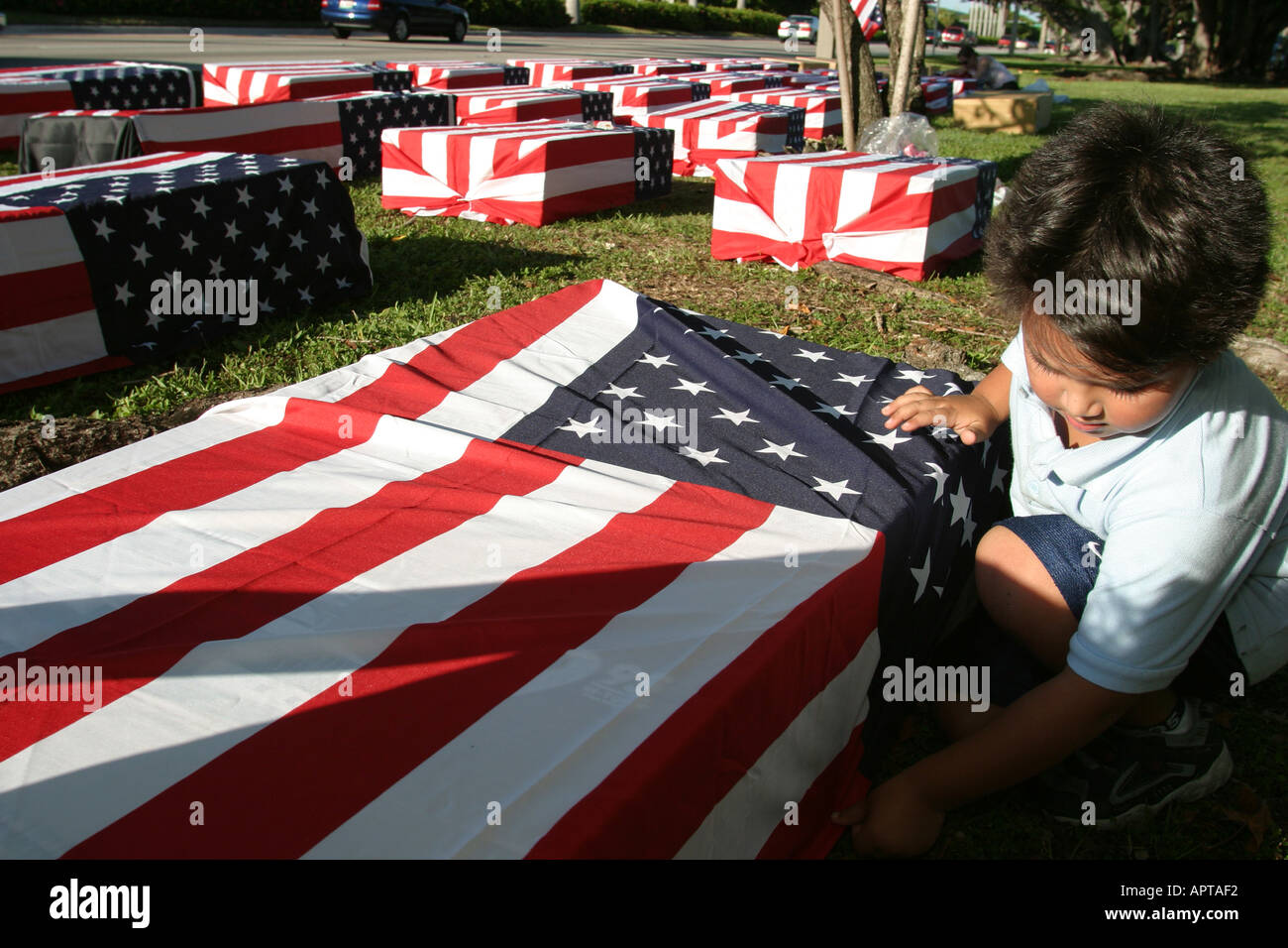Coral Gables Miami Florida Presidential debate protesting mock US flag draped coffins symbolize Iraqi War dead Hispanic Stock Photo