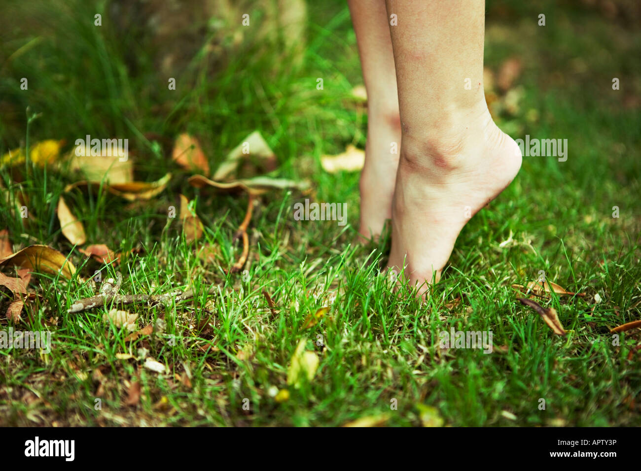 Girl on tiptoe four year old - Stock Image