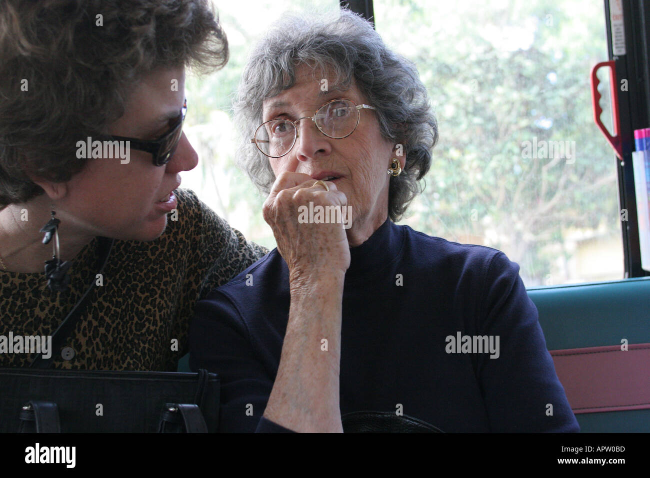 98298b69af6 Miami Beach Florida Electrowave public bus passengers senior mother adult  daughter - Stock Image
