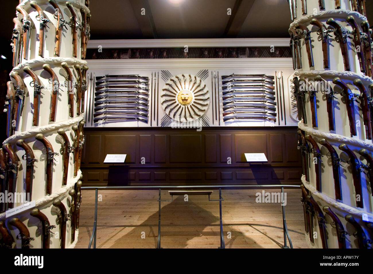 Pistols and rifles on display at the Royal Armories in the White Tower at the Tower of London in London UK Stock Photo