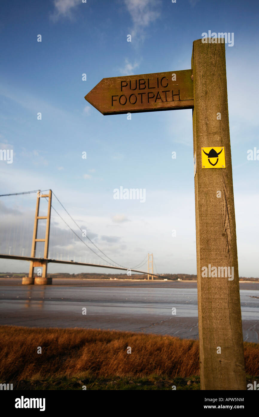 Sign indicating the route of the Viking Way Long Distance Footpath, Barton upon Humber, with Humber Bridge in Background - Stock Image