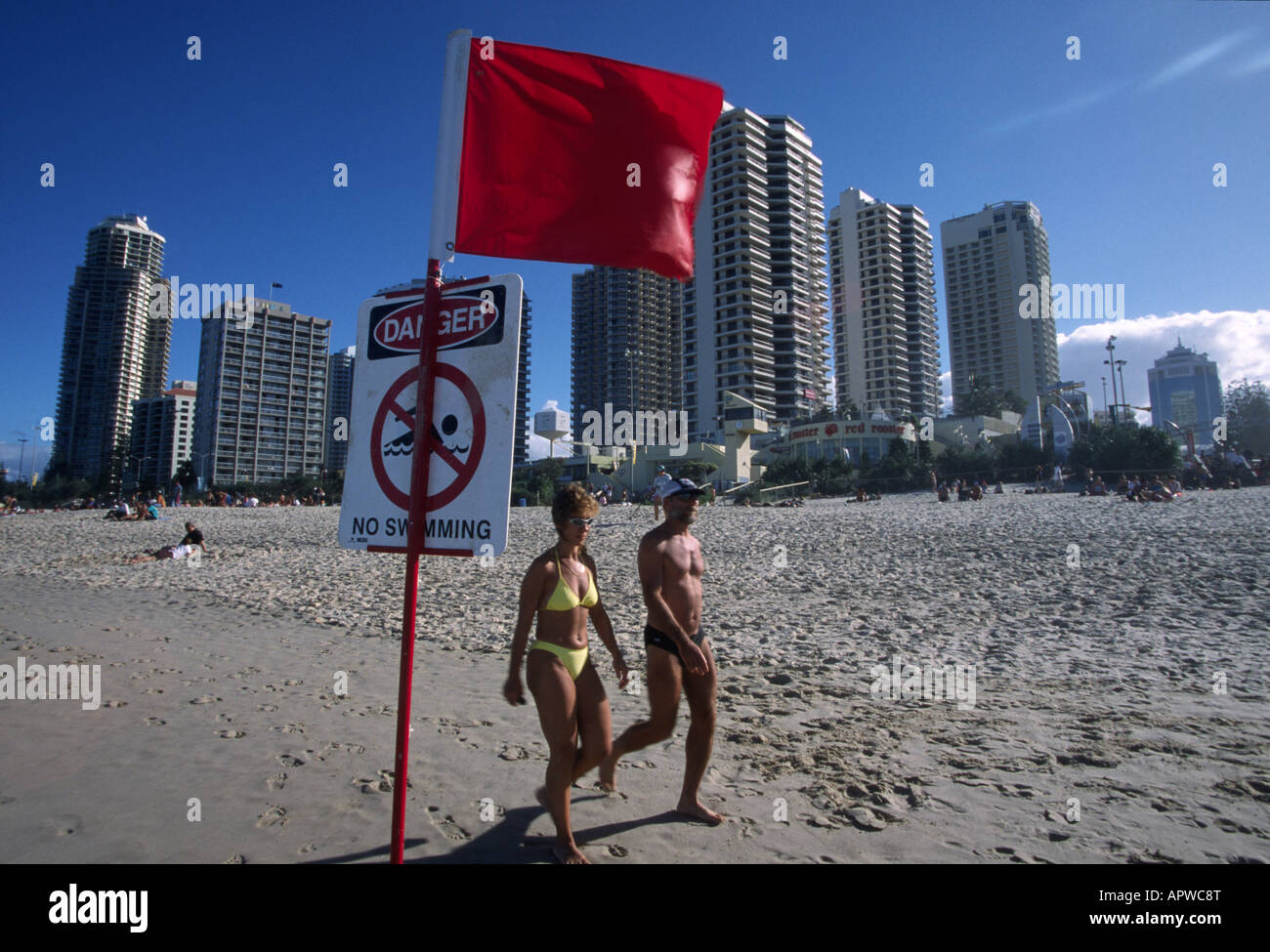 couple on beach surfers paradise - Stock Image