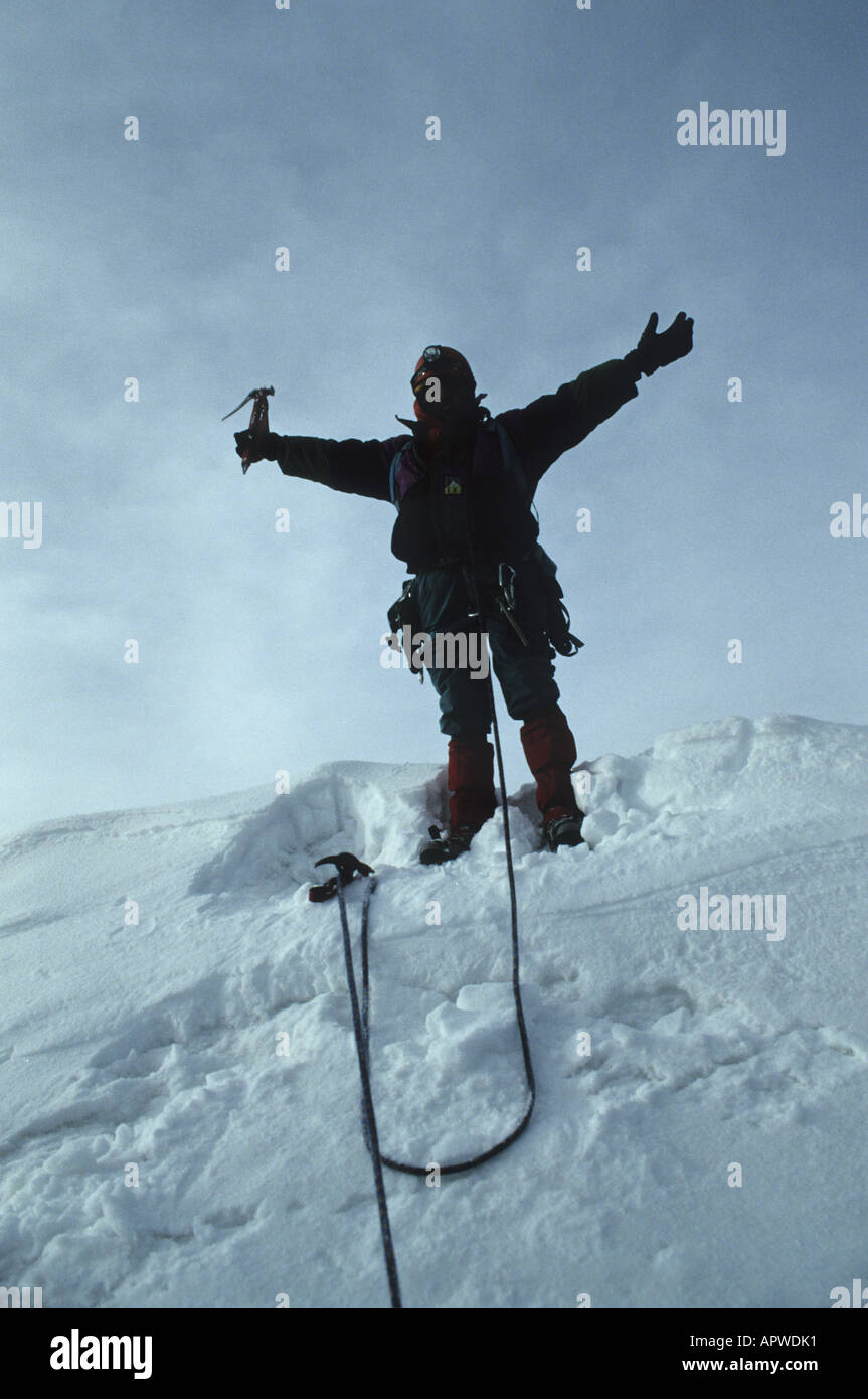 Alpinist spreading his arms on the summmit of the 6088 m high Huyana Potosi, 25 km north of La Paz, Bolivia. - Stock Image