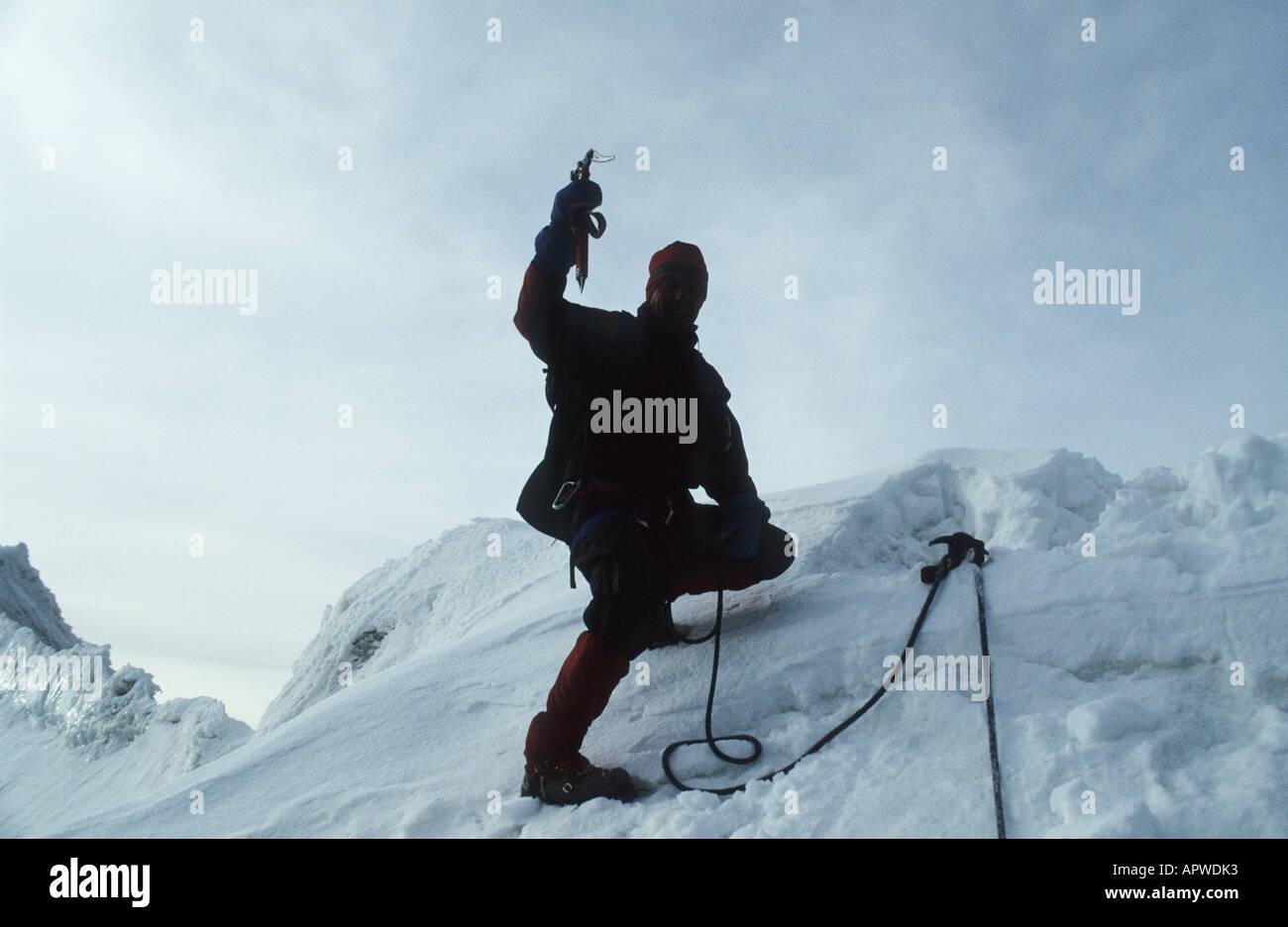 Cheering alpinist on the summmit of the 6088 m high Huyana Potosi, 25 km north of La Paz, Bolivia. - Stock Image